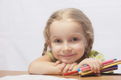 Portrait of a little blond girl with pencils Royalty Free Stock Photo