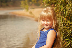 Portrait of little blond girl on vacation in park Royalty Free Stock Image