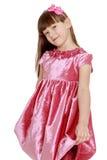 Portrait of little blond in red velvet dress Stock Photos