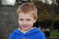 Portrait of little blonde child. Portrait of little caucasian boy in the park stock image