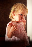 Portrait of little blonde girl in pink under sunlight Royalty Free Stock Photos