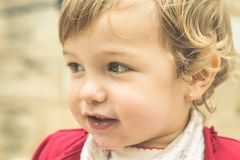 Portrait of a little blonde girl smiling royalty free stock photos