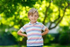 Portrait of little blonde preschool kid boy Stock Photo