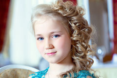 Portrait of little blue-eyed girl with ringlets Royalty Free Stock Photos