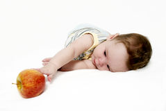 Portrait of the little boy with an apple Royalty Free Stock Photography