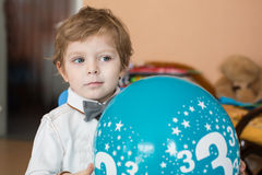 Portrait of little boy with baloon at his 3 birthday. Portrait of little blond boy with baloon at his 3 birthday Stock Images