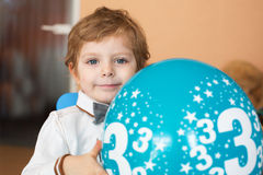 Portrait of little boy with baloon at his 3 birthday. Portrait of little blond boy with baloon at his 3 birthday Royalty Free Stock Photos