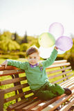 Portrait of a little boy with baloons Royalty Free Stock Images