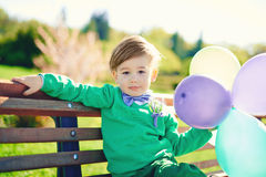 Portrait of a little boy with baloons Royalty Free Stock Image