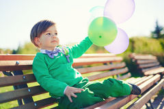 Portrait of a little boy with baloons Royalty Free Stock Photo