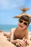 Portrait of little boy on the beach Stock Photos