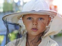 Portrait of a little boy beekeeper. Beekeeping stock photo