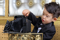 Portrait of a little boy in black tuxedo Stock Photo