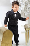 Portrait of a little boy in black tuxedo Stock Photos