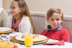 Portrait of little boy during christmas dinner Stock Photo