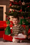 Portrait of little boy with Christmas tree Royalty Free Stock Images