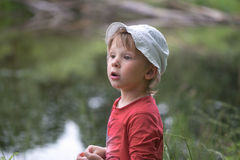 Portrait of a little boy close-up in nature. Stock Photo