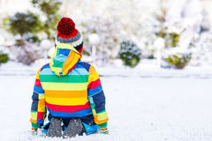 Portrait of little boy in colorful clothes in winter, outdoors Stock Images