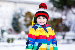 Portrait of little boy in colorful clothes in winter, outdoors Royalty Free Stock Photo