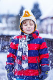 Portrait of little boy in colorful clothes in winter, outdoors Royalty Free Stock Image