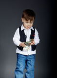 Portrait of little boy counting money Stock Photo