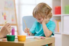 Portrait of little boy drawing something for art class Stock Photos