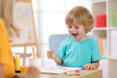 Portrait of little boy drawing something for art class Royalty Free Stock Photography