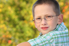 Portrait of little boy in early fall park Stock Photography