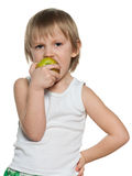 Portrait of a little boy eating an apple Stock Images