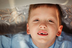 Portrait little boy in fall missing his first milk tooth. Stock Photo