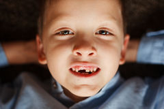 Portrait little boy in fall missing his first milk tooth. Royalty Free Stock Photo