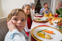 Portrait of little boy with a funny face at christmas dinner Stock Image
