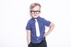Portrait of a little boy in a funny glasses and tie. School. Preschool. Fashion. Studio portrait isolated over white background Stock Photography