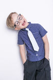 Portrait of a little boy in a funny glasses and tie. School. Preschool. Fashion. Studio portrait isolated over white background Royalty Free Stock Photo