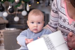 Portrait of a little boy with a gift. New Year. `s holidays Stock Images