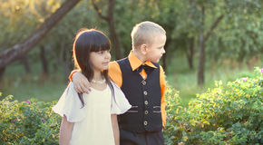 Portrait of a little boy and girl. Sits  in beautiful dress Stock Images