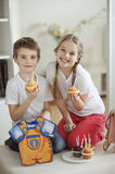 Portrait of little boy and girl with cup cakes Stock Image