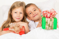 Portrait of a little boy and girl with gifts in hands Royalty Free Stock Image