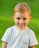 Portrait of little boy on green grass field. Portrait of little boy on sunny green grass field Royalty Free Stock Photo