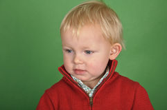 Portrait of a little boy on a green screen Stock Photos