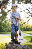 Portrait of a little boy with guitar Royalty Free Stock Photo