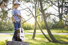 Portrait of a little boy with guitar Stock Photography
