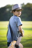 Portrait of a little boy with guitar Royalty Free Stock Photos