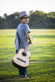 Portrait of a little boy with guitar Stock Photos