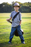 Portrait of a little boy with guitar Royalty Free Stock Photography