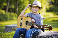 Portrait of a little boy with guitar Royalty Free Stock Images