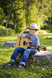 Portrait of a little boy with guitar Stock Photo