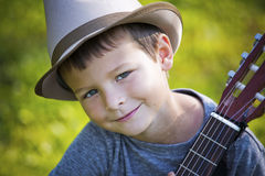 Portrait of a little boy with guitar Stock Image