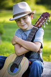Portrait of a little boy with guitar Stock Images