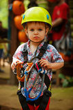 Portrait  little boy having fun in adventure park loking to came Stock Image